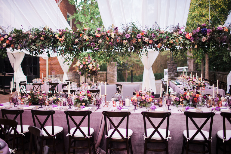 Ultra Violet wedding reception at The First Learning Center at Cheekwood with a loose organic hanging feature over the velvet linen clad head table wedding by Nashville wedding planner and designer Sage Nines Event Production